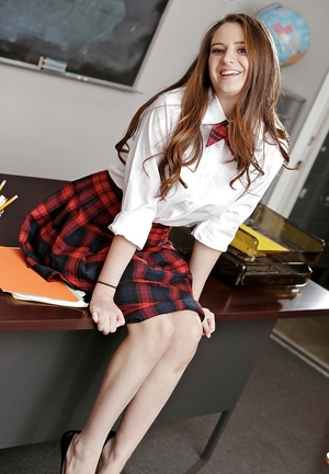 Schoolgirl with natural breasts strips and poses impertinently on the teacher's desk