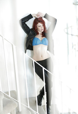 Wonderful red-haired pornstar Bree Daniels gives a show of her body on the stairs