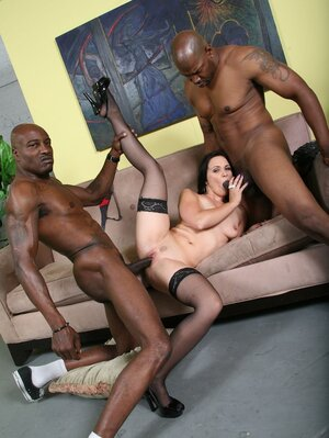 Seducing pale-skinned floozy enjoys black cocks in cunt and asshole at once