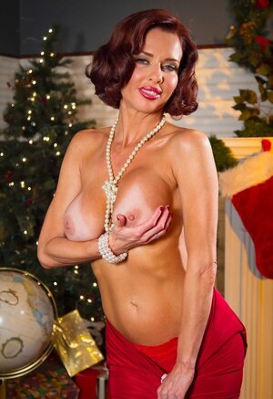 Staggering Sexually available mom with red hair and plus tan lines waits for good cock for Christmas