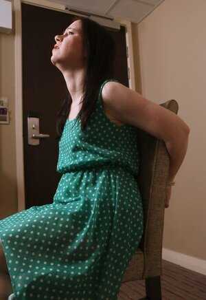 Pervert catches lady in green polka dot dress and furthermore ties her to chair