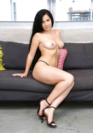 Long-haired gal with natural boobs and additionally sexy legs poses in individual gallery
